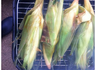 Corn in husk on the grill