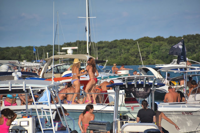 girls dancing on boat