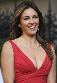 Liz Hurley sizzles in sleeveless scarlet red dress