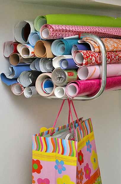 a large bike hook to hold wrapping paper rolls! OrganizingMadeFun.com