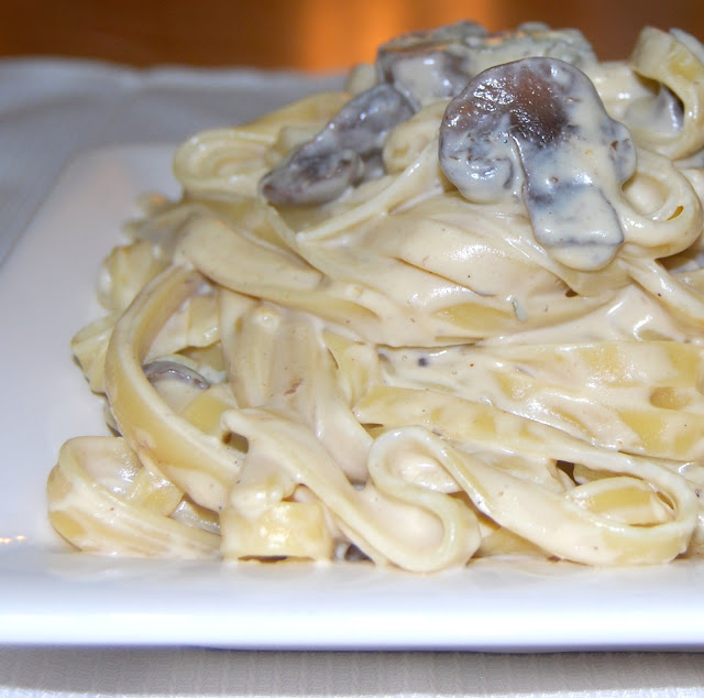 Creamy Vegan Fettuccine Alfredo with mushrooms on a white square plate