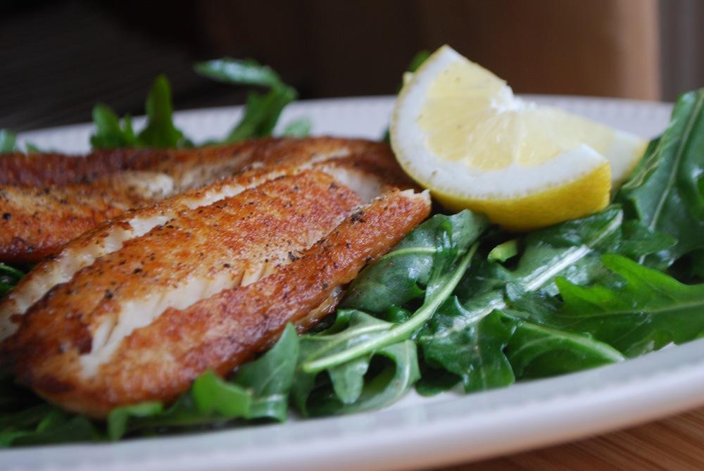 Crispy pan fried tilapia with lemony baby arugula salad for Fried tilapia fish
