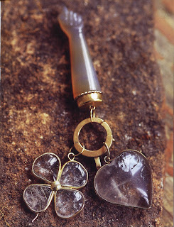 A heart, a four-leaf clover, and a clenched first (known as figa in Brazil) are some of the most popular good luck charms. Made of yellow agate and quartz, these are from Brazil.