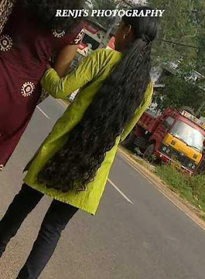 Kerala long hair college girl wearing jeans and tops in loose open hair style.