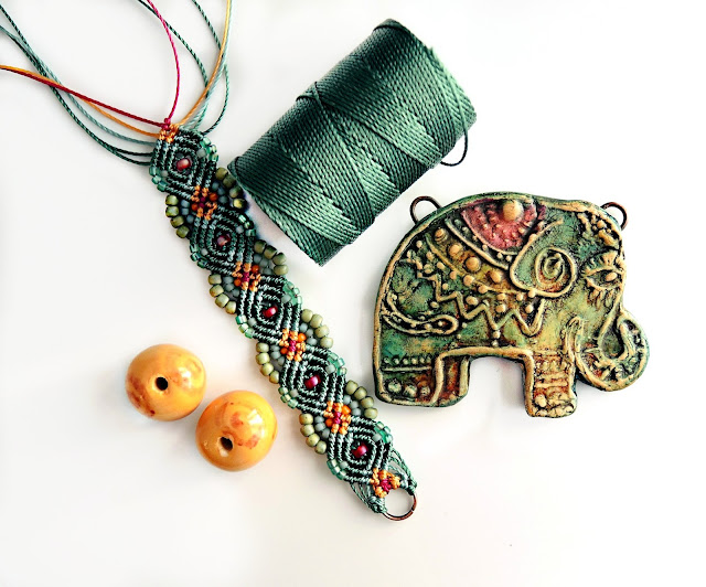 Polymer pendant and macrame knotting with the addition of beads.