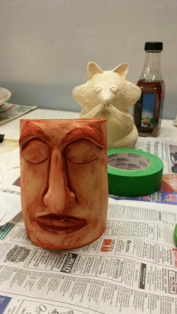 Sleeping ceramic stoneward face for the garden (bottomless planter) - not fired yet.