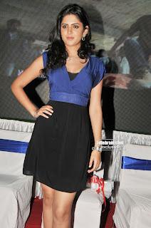 Deeksha Seth in Mini Skirt attending a party sitting pose Spicy Pictures Deeksha seth