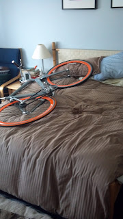 a bicycle laying in a bed