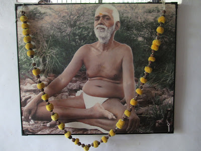 Ramana Maharshi sitting cross legged