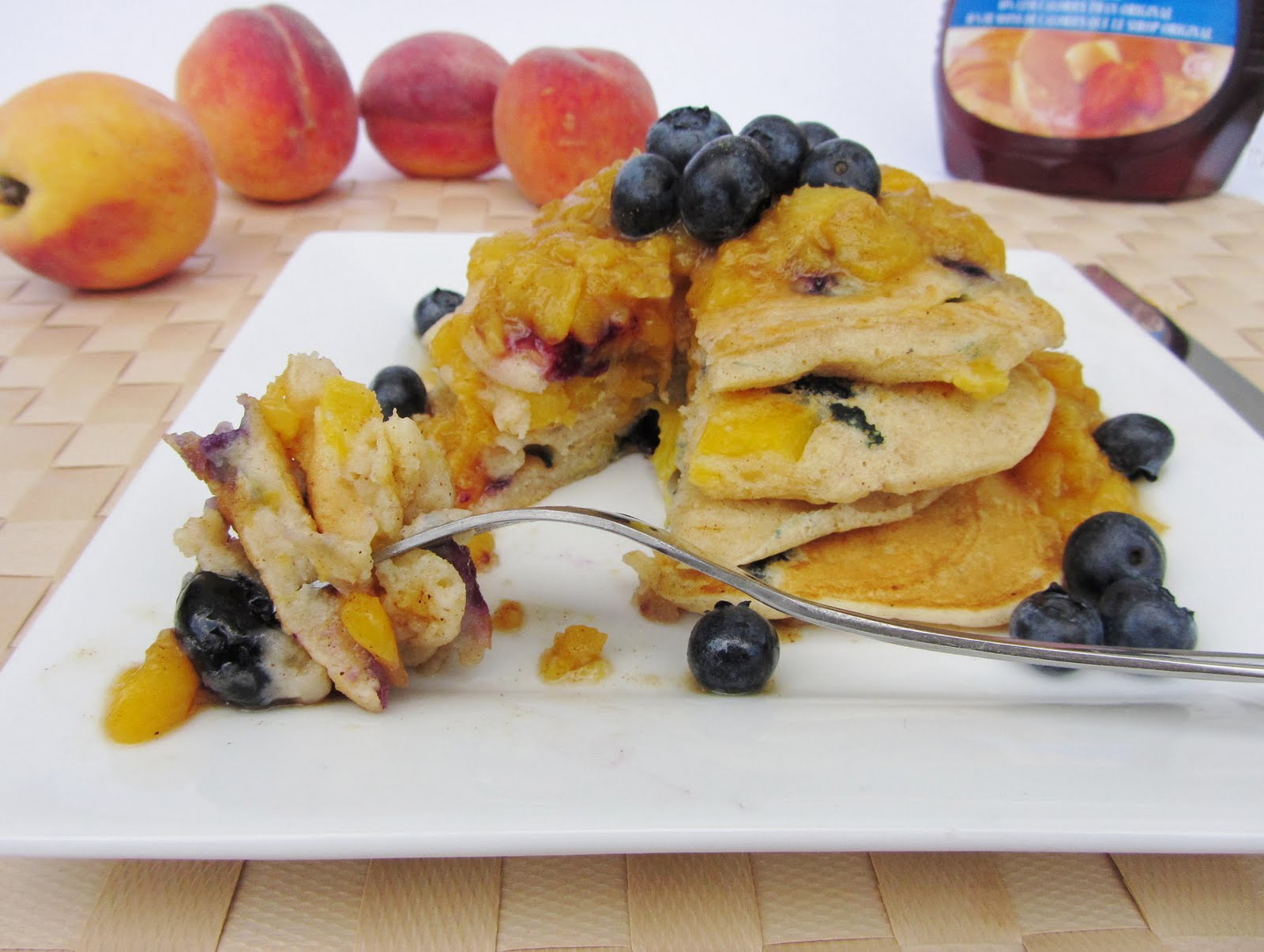 peach blueberry pancakes with peach sauce