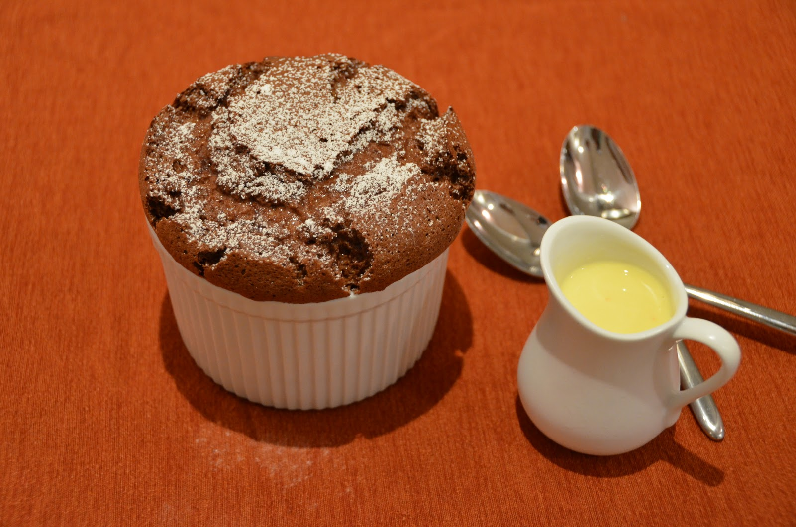 Chocolate soufflé with orange crème anglaise