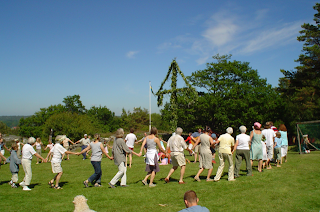 People dancing around a Midsummer's pole in Sweden.