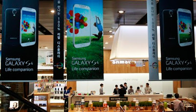 Banners advertising Samsung Electronics' Galaxy S4 smartphones are displayed at a showroom of its headquarters in Seoul, South Korea, Friday, April 26, 2013. Samsung Electronics Co. said Friday its first-quarter net income jumped to a record high because sales growth in smartphones continued even before the launch of the Galaxy S4 during a typically slow season for the electronics market. (AP Photo/Ahn Young-joon)