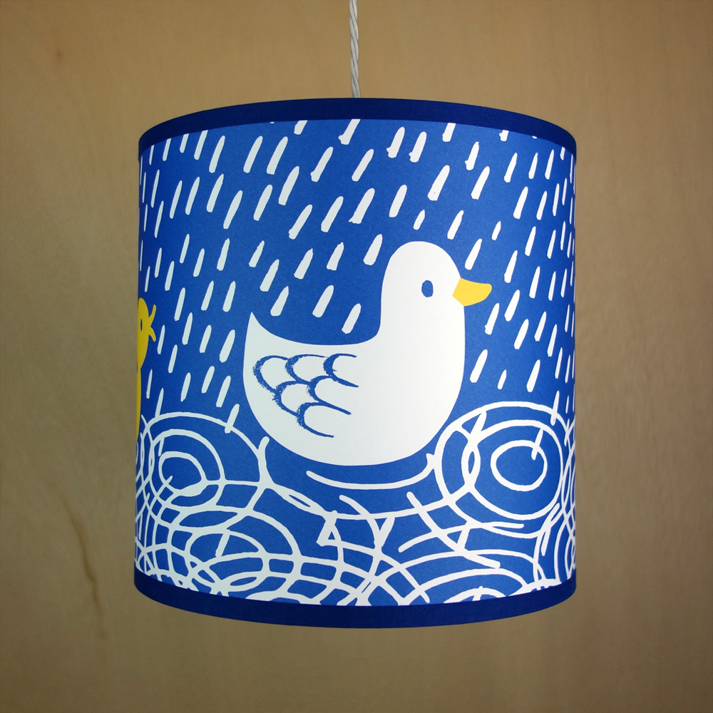 Handmade drum lampshade illustrated with duck and chicks swimming in the rain
