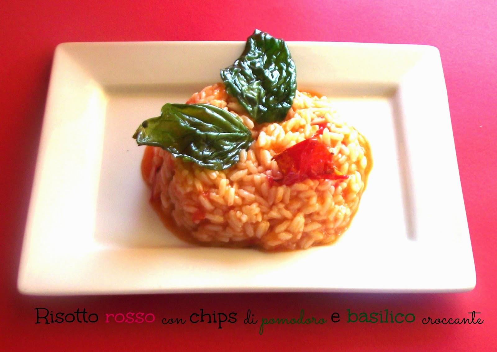 risotto rosso con chips di pomodoro e basilico croccante e la promessa