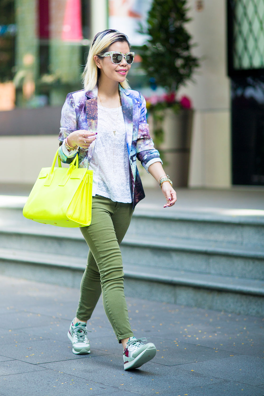 Crystal Phuong- Going green with printed blazer, neon Sac de jour bag, and Dolce Gabbana sneakers