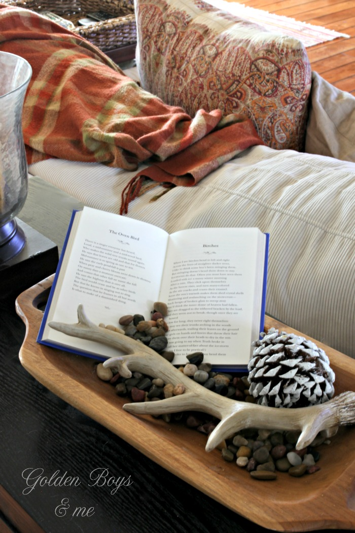 Robert Frost poem book displayed in wood dough bowl with antler on console table - www.goldenboysandme.com