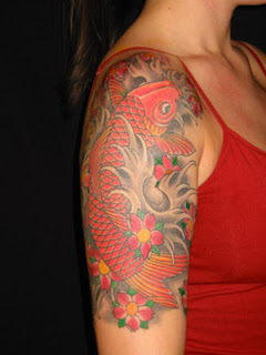 Japanese Red Koi Fish Tattoo on Girls Upper Arm
