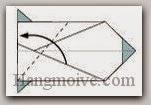 Bước 13: Gấp chéo cạnh giấy sang trái.