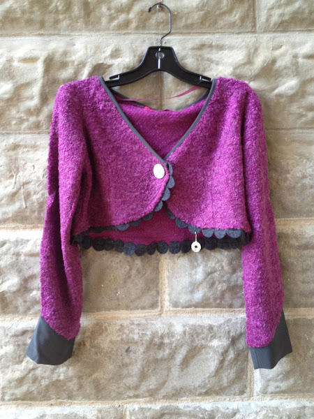 Raspberry boucle jacket with felted trim and pearl button.