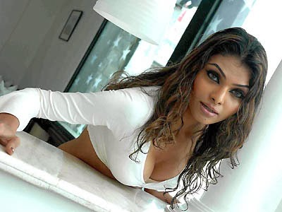 Mona Chopra exposing her hot huge cleavage in white top and black Shorts Unseen rare Hot Pics