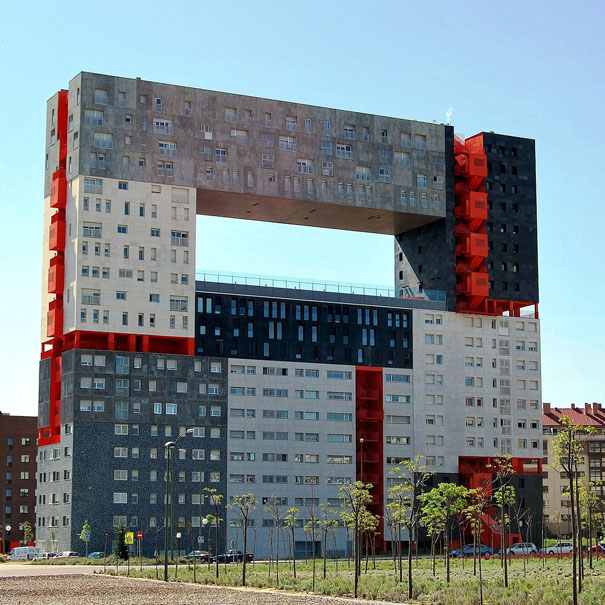 It's a building developed by Dutch architects MVRDV. The building reaches 63.4 meters in height with 21 stories. The highlight of this building is the large central hole which is 36.8 meters above the ground. It's the large lookout area that provides inhabitants with a community garden and a space from where they can contemplate the skyline.Different colors represent different blocks with its own planning, which offer at least 9 different types of apartments.