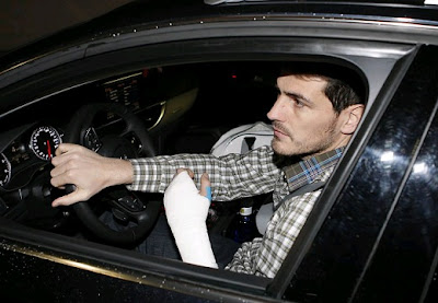 Casillas wearing a visible bandage on his left hand