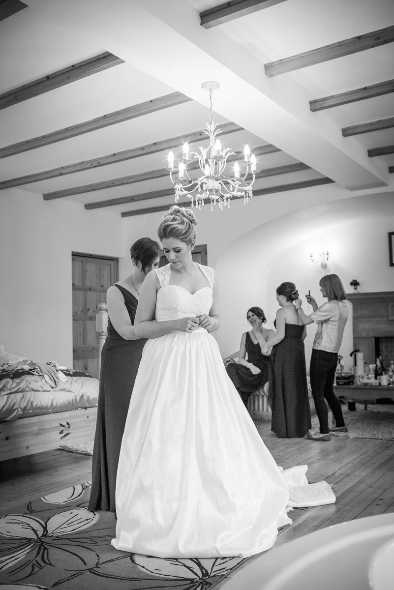 Bride Alison in her elegant bridal gown in the bridal suite at Achnagairn House
