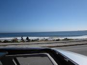 Third Stop: Ocean beach. Reading on the beach while my Hungry Bear enjoys a .