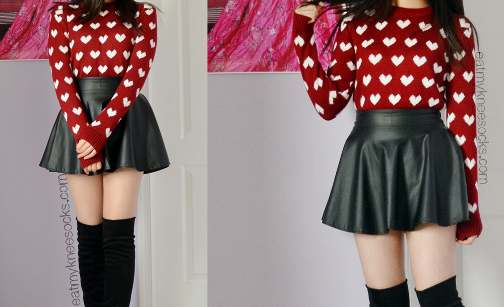 The Sweetbox Store wine red heart sweater, worn with a leather skater skirt and black over-the-knee boots.