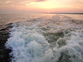 Sun sets on Oneida Lake search.