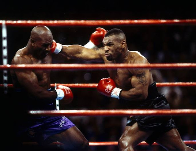 Evander Hollifield against Mike Tyson, 1996