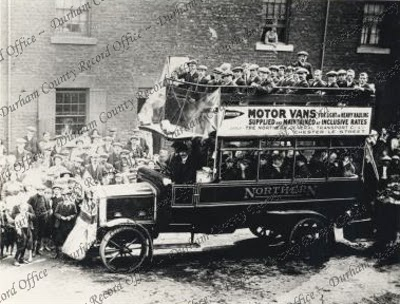 Image of a Northern General Transport Company bus, thought to be carrying First World War volunteers at Birtley in 1915 (D/CL 27/277/30)