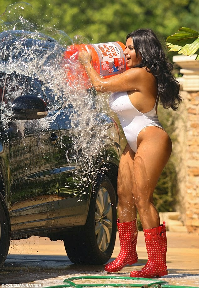 Mercedes Javid in G-string swimsuit while washing her car