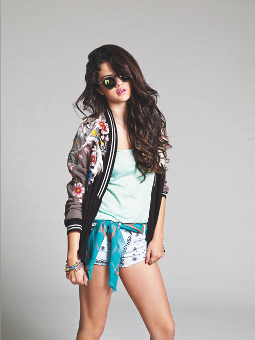 Selena Gomez wears basketball jersey over a bikini top for the cover of Nylon, February 2013