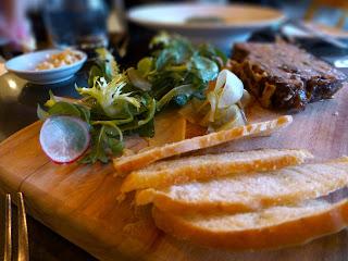 Duck and prune terrine, mustard, pear and cornichons