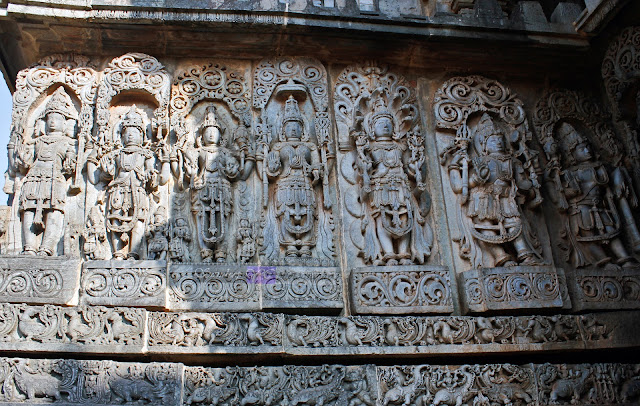 Panel of sculptures of Gods and Goddesses, with seven images