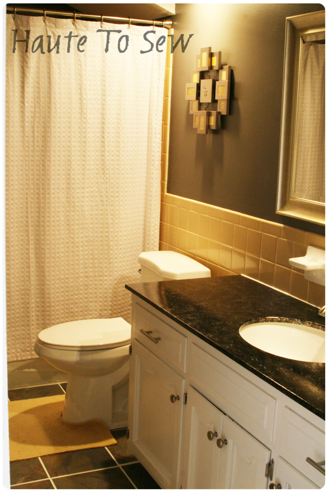 Remodelaholic bathroom makeover yellow gray color scheme for Bathroom remodel color schemes
