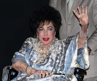 Hollywood Actress Elizabeth Taylor - Last Age at Wheel Chair in a Party