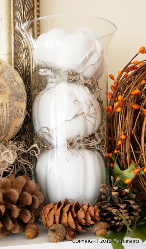 Craftiments:  Dollar store pumpkins painted white and displayed in a cylinder vase