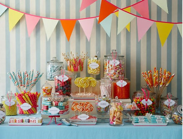 setting up a cute candy buffet with the decorations and all Heheheh