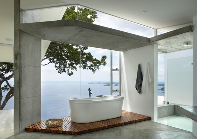 Picture of the minimalist bathtub on the wooden floor by the window overlooking the ocean