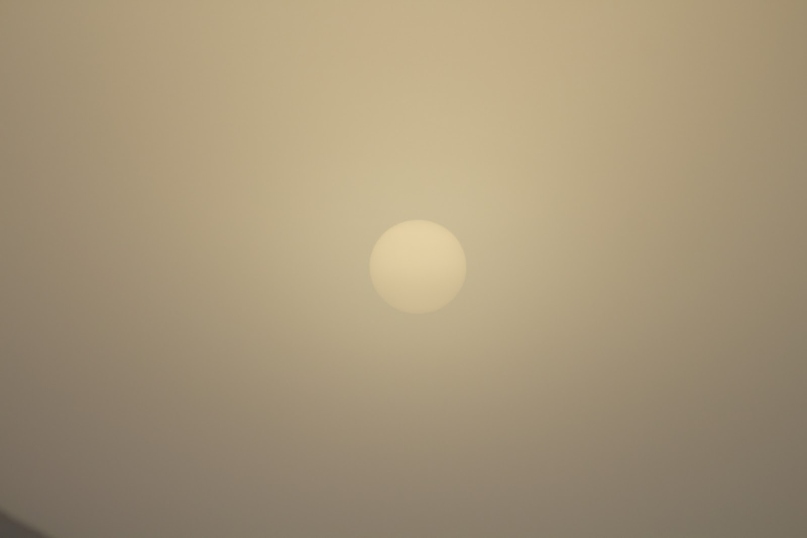 yellow sun through fog