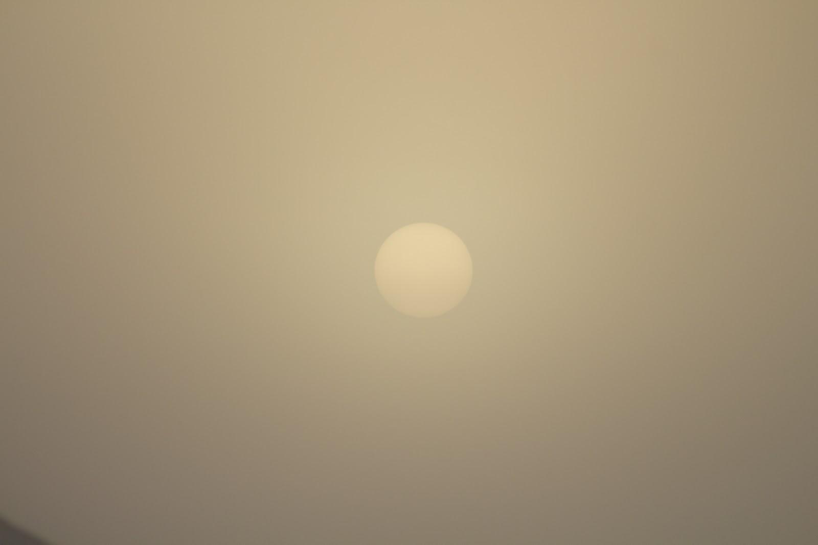 yellow sun through fog