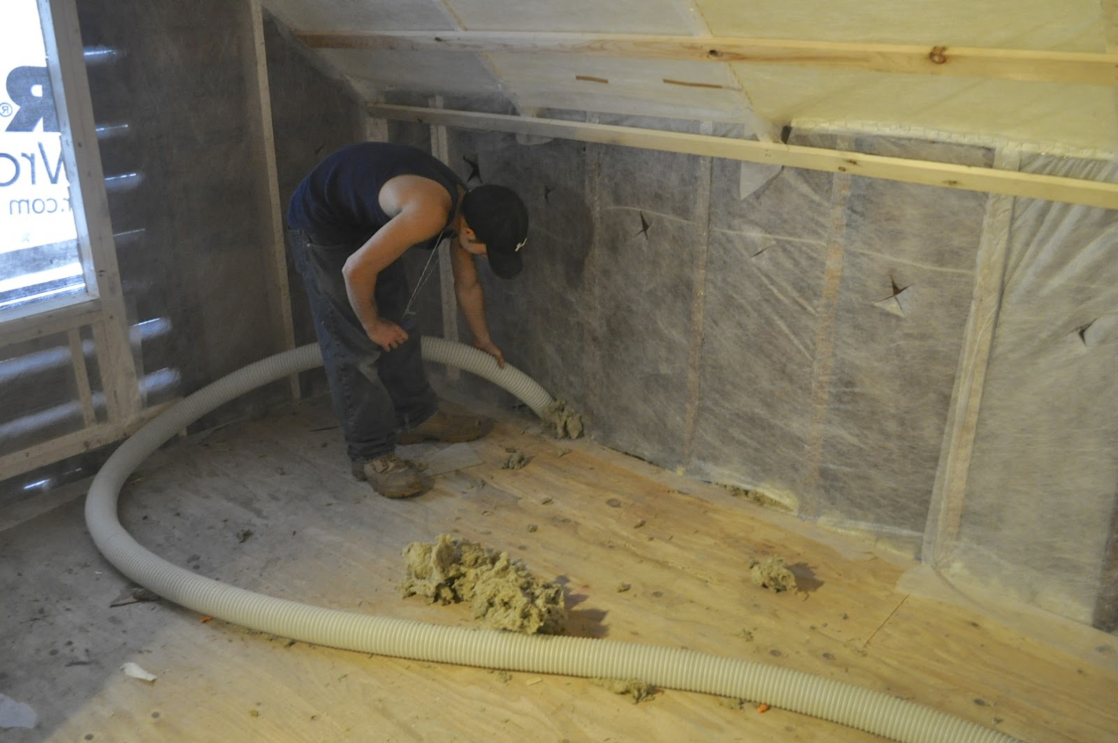 How to insulate old house - Shooting Dense Pack Cellulose To The First Floor