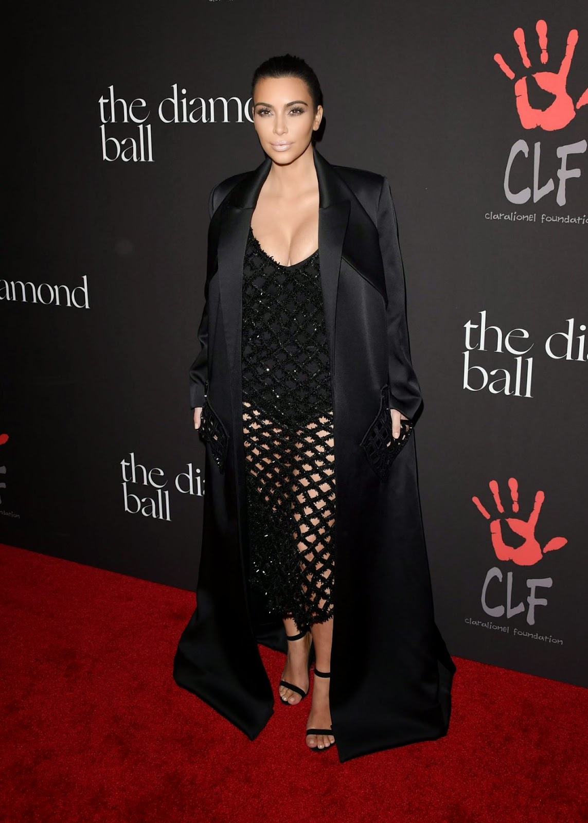 Kim Kardashian in a sheer sequinned dress at Rihanna's Diamond Ball Benefit in Beverly Hills