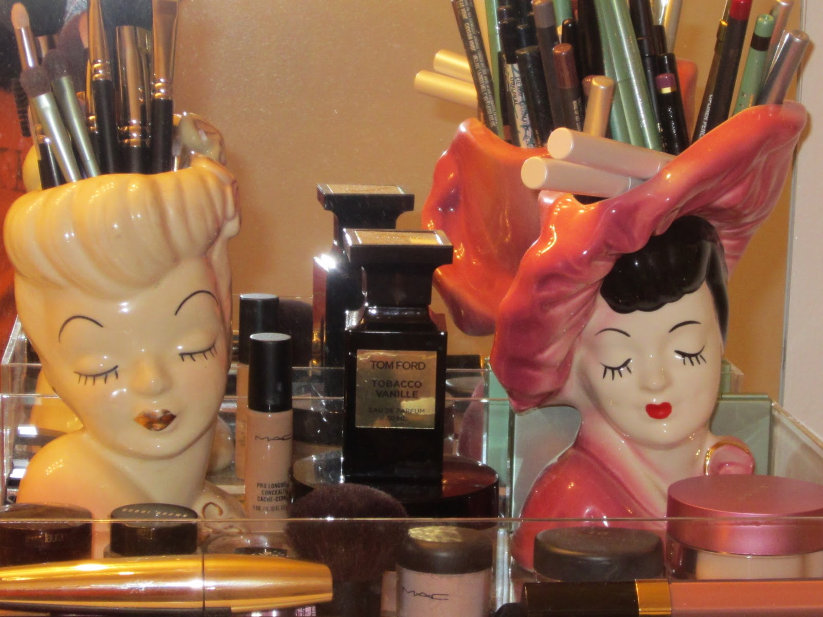 Christinas beauty mark my makeup organized i also collect vintage glamour girl head vases i use them to hold my makeup brushes eyeliner and lipliners reviewsmspy