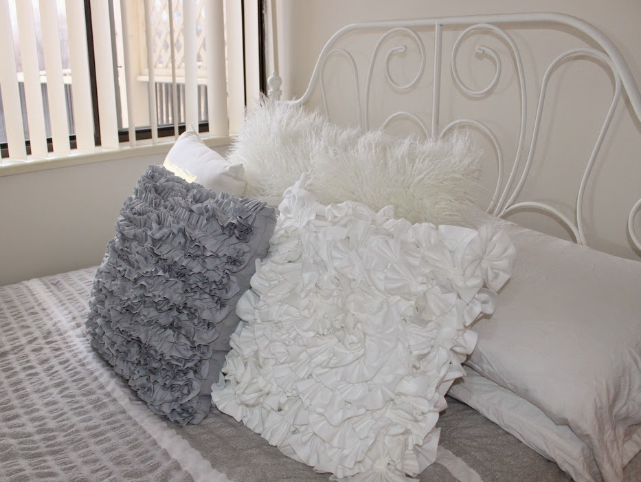 how to decorate small room, neutral bedroom, white bed and grey comforter, glass night stand table, Ikea leirvik bed