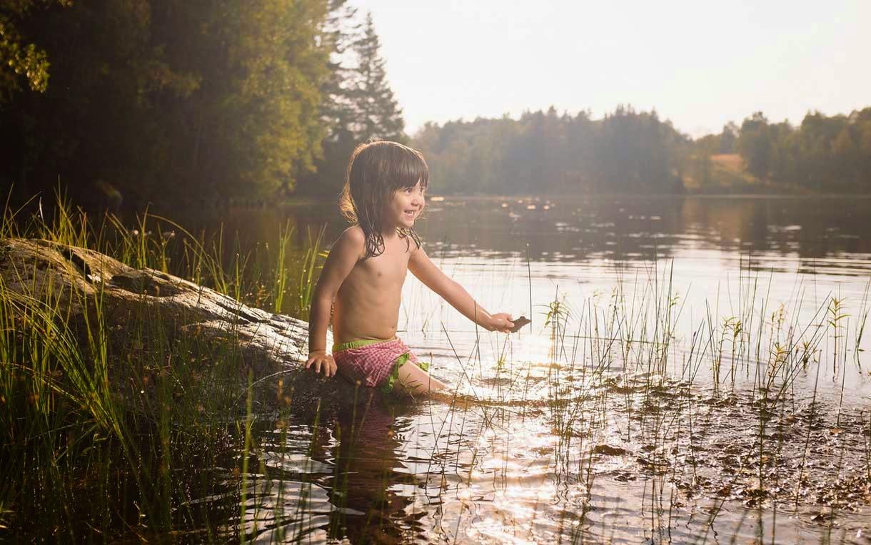 Child Sit at Pond Side