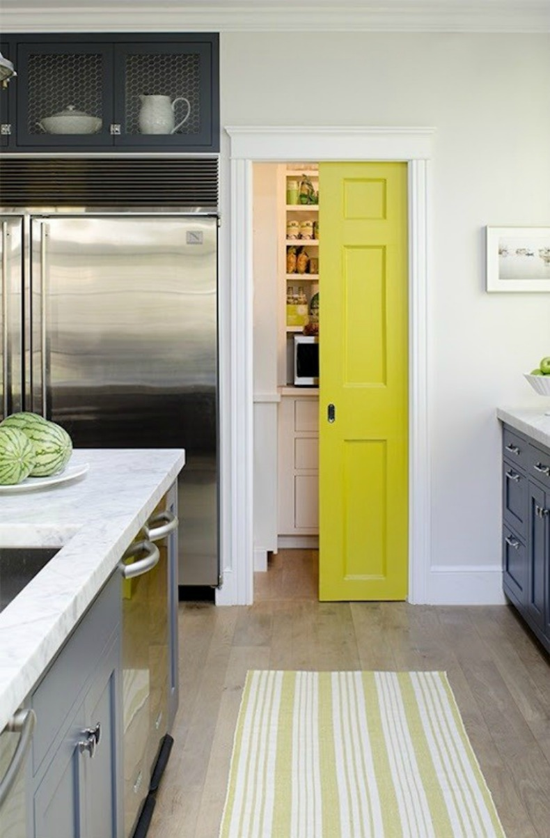 Modern coastal kitchen with yellow painted door for a pop of color